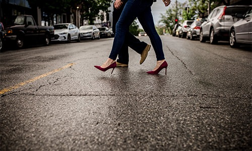 Couple walking across an urban street